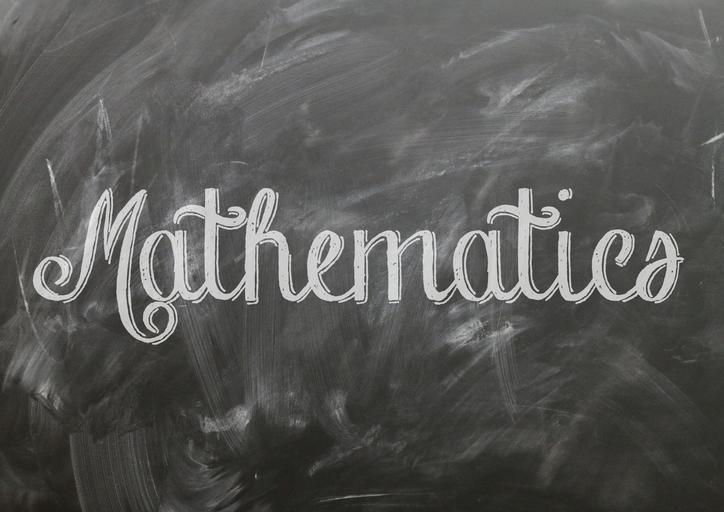 The word Mathematics written in large calligraphic letters, in chalk, on a black board.